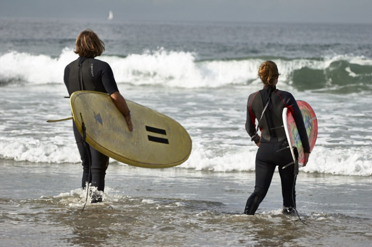 The Director taking Amanda out for daily surf practice.