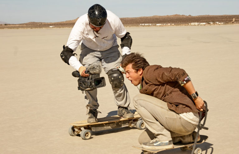 Riding an electric skateboard allowed the Director to get really close to the actors, in the middle of an action scene.