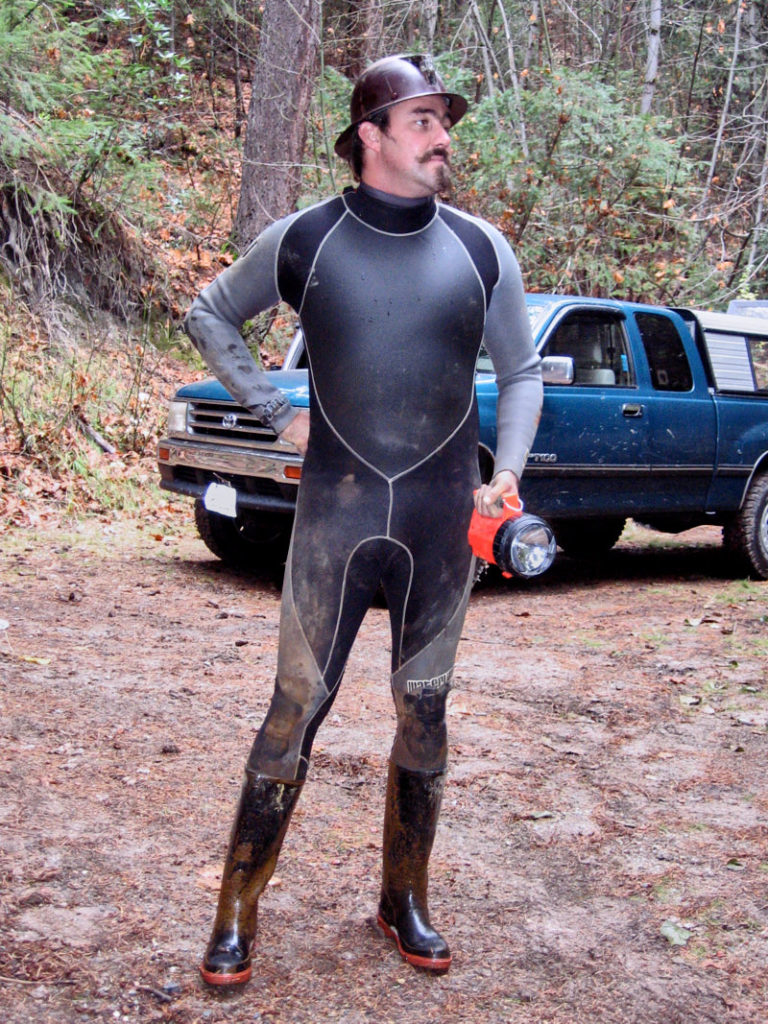 The Director decided the best outfit to shoot in a muddy mine, to be a wetsuit…